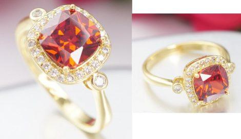 Arany színű gyűrű piros kristályberakással