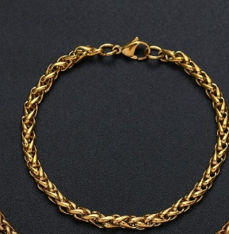 Fonott kialakítású acél karkötő arany színben