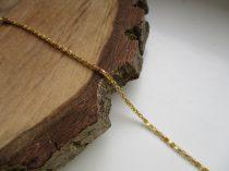 Csillogó vékony acél karkötő arany színben