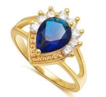 Arany színű gyűrű kék és fehér kristályokkal