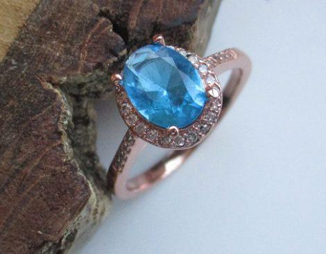Rózsaarany színű gyűrű ovális kék kristállyal